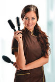 Professional hairdresser holding brushes Royalty Free Stock Photography