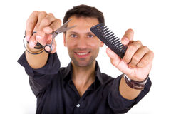 Professional hairdresser holding scissors and comb Stock Image