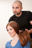 Professional hairdresser with long hair customer Royalty Free Stock Photography