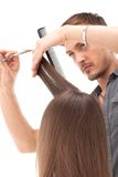 Professional hairdresser with long hair model Royalty Free Stock Image