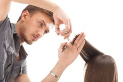 Professional hairdresser with long hair model Royalty Free Stock Images