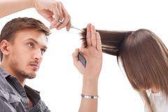 Professional hairdresser with long hair model Royalty Free Stock Photo