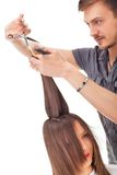 Professional hairdresser with long hair model Stock Photo