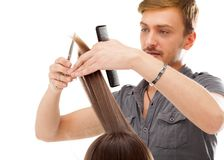 Professional hairdresser with long hair model, isolated on white royalty free stock image