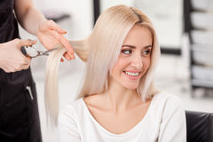 Professional hairdresser is making haircut for Stock Photos