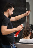 Professional hairdresser man at work Royalty Free Stock Image