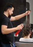 Professional hairdresser man at work Royalty Free Stock Image