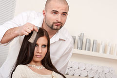 Professional hairdresser at salon Stock Image