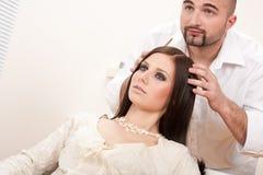 Professional hairdresser at salon Stock Photos