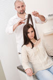 Professional hairdresser with scissors at salon Stock Photos