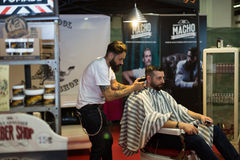 Professional hairdresser shaving back of the mens head Stock Images