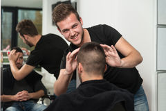 Professional Hairdresser With Short Hair Model Royalty Free Stock Photos