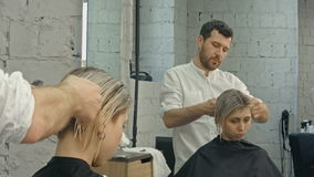Professional hairdresser with short hair model stock footage