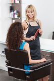 Professional hairdresser standing near client Stock Photos