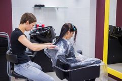 Hairdresser cutting hair of woman client Royalty Free Stock Photography
