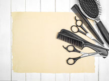 Professional hairdresser tools on table close-up. Isolated on a wooden background Royalty Free Stock Photos