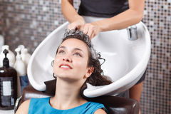 Professional hairdresser washing head Royalty Free Stock Images