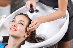 Professional hairdresser washing head Royalty Free Stock Image