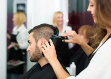 Professional hairdresser at work Royalty Free Stock Photo