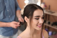 Professional hairdresser working with client in beauty salon. Professional male hairdresser working with female client in beauty salon Stock Image