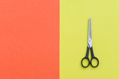 Professional hairdressing scissors on yellow and orange backgrou Stock Images