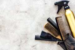 Professional hairdressing tools and accessories on stone table background top view copyspace Royalty Free Stock Photo