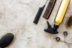 Professional hairdressing tools and accessories on stone table background top view copyspace Royalty Free Stock Photography