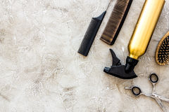 Professional hairdressing tools and accessories on stone table background top view copyspace Royalty Free Stock Image