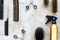 Professional hairdressing tools and accessories on stone table background top view copyspace Royalty Free Stock Photos
