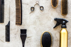Professional hairdressing tools and accessories on stone table background top view copyspace. Professional hairdressing tools and accessories on stone table Royalty Free Stock Photography