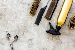 Professional hairdressing tools and accessories on stone table background top view copyspace. Professional hairdressing tools and accessories on stone table Stock Image