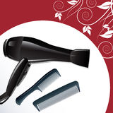 Professional hairdryer and two combs. Against white and red background decorated with floral ornament Royalty Free Stock Images