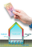 A professional hand holding a light bulb - An expert can solve t. He problem of radon in our homes - Radon solution concept image stock photos