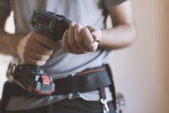 Free Professional Handyman Changing A Drill Bit Royalty Free Stock Photo - 127697055