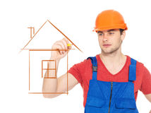 Professional handyman drawing house. With marker Stock Images