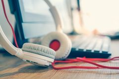 Professional headphone in soft focus with blurred computer Stock Images