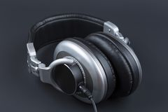 Professional headphones with wire on a dark background. Stock Photography
