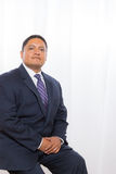 Professional Hispanic Male In Suit With Confident Expression Stock Image