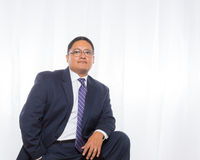 Professional Hispanic Male In Suit With Confident Expression Royalty Free Stock Photography