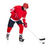 Professional hockey player skating on ice. Isolated on white Royalty Free Stock Image