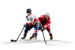 Professional hockey player skating on ice. Isolated in white Royalty Free Stock Images