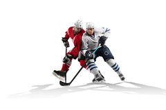 Professional hockey player skating on ice. Isolated in white Stock Photography