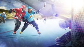 Professional hockey players in action on grand arena stock images