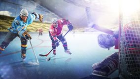 Professional hockey players in action on grand arena royalty free stock photos