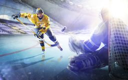 Professional hockey players in action on grand arena stock photos