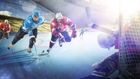 Professional hockey players in action on grand arena royalty free stock photography
