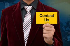 Professional holding contact us card in hand with Royalty Free Stock Images