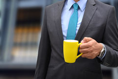 Professional Holding cup of coffee front office view Royalty Free Stock Photos