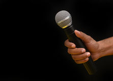 Professional holding microphone in hand while giving motivational speach Stock Images