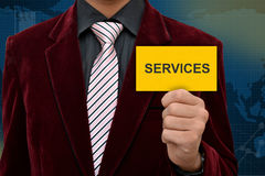 Professional holding Services card in hand Stock Images